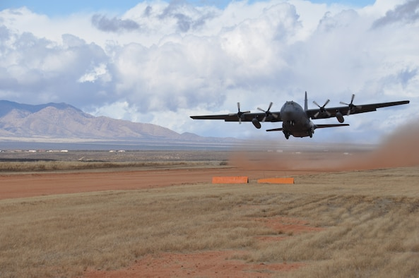 A C-130 from the 94th Airlift Wing, Dobbins Air Reserve Base, takes off from a dirt runway in Arizona on Dec. 17, 2014. The plane had just landed, and took turns landing with another C-130 during training. (U.S Air Force Photo by Senior Airman Miles Wilson)