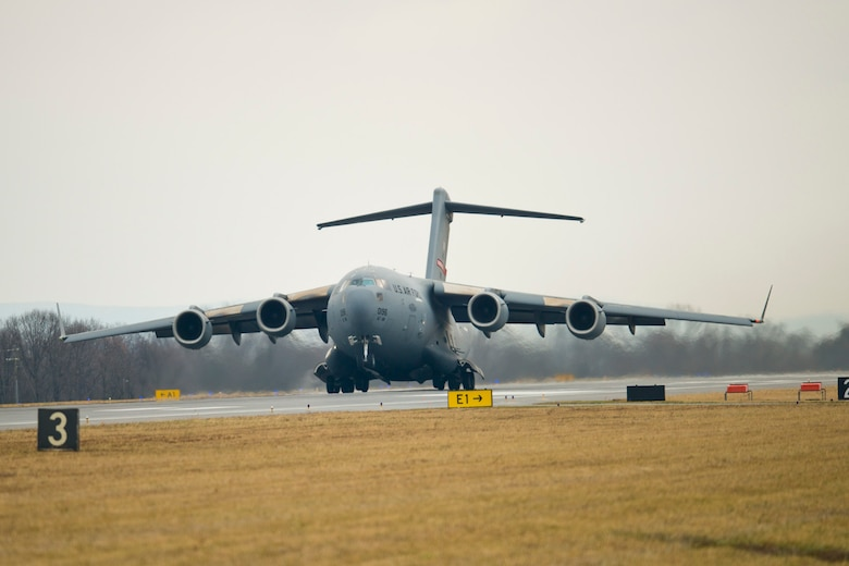 The front wheels of a C-17 Globemaster III lift off the runway at the 167th Airlift Wing, West Virginia Air National Guard base in Martinsburg, W.Va., Dec. 18. This marked the first launch, a local training sortie, for the wing that is currently in conversion from the C-5 Galaxy to the C-17. The unit received its first C-17 aircraft Sept. 25. (Air National Guard photo by Master Sgt. Emily Beightol-Deyerle/released)