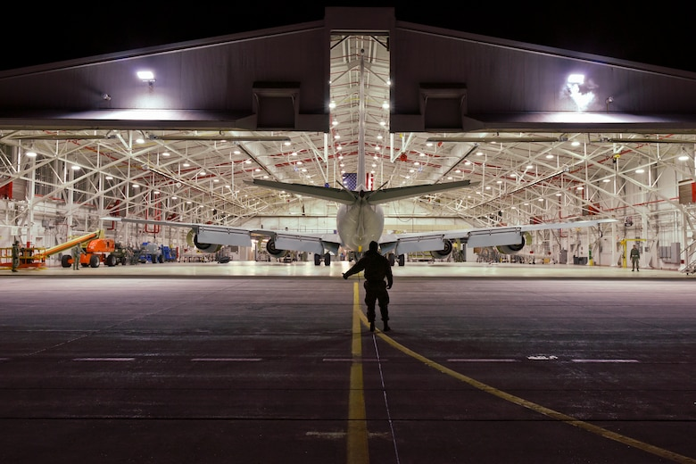 Airmen of the 191st Aircraft Maintenance Squadron begin their day by towing a KC-135 Stratotanker out of a hangar at Selfridge Air National Guard Base, Mich., in the pre-dawn hours of Dec. 19, 2014. Each aircraft undergoes a complete inspection, known as an ISO or isochronical inspection, at various points in the aircraft's operational cycle. (U.S. Air National Guard photo by Terry Atwell)