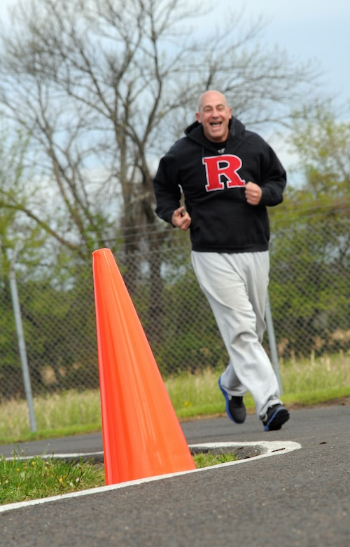 Master Sgt. John Parillo, 111th Air Operations Group unit deployment manager, gives a reassuring smile as he rounds the corner at the halfway point during the unit's annual physical fitness assessment May 2014, Horsham Air Guard Station, Horsham, Pa.