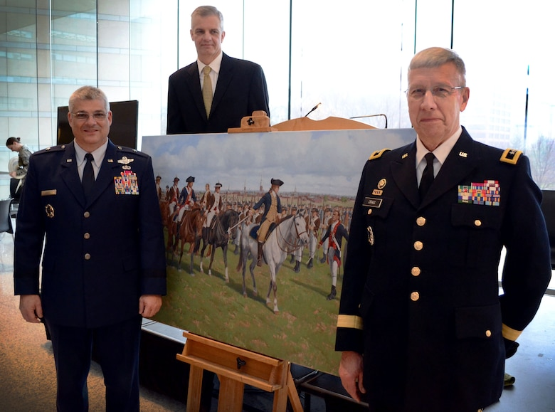 """Brig. Gen. Tony J. Carrelli, Pennsylvania National Guard deputy adjutant general – air (left), Maj. Gen. Wesley E. Craig, Pa. National Guard adjutant general (right) and artist Larry Selman pose in front of Selman's painting, """"Washington's Review"""", Dec. 6, 2014, at the National Constitution Center, Philadelphia, Pa. The painting was commissioned on behalf of the Pa. National Guard and unveiled during its 267th birthday celebration. (U.S. Air National Guard photo by Master Sgt. Christopher Botzum/Released)"""