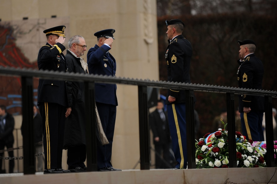 U.S. Army Lt. Gen. Ben Hodges, U.S. Army Europe commander, left; Robert Mandell, U.S. Ambassador to Luxembourg, center; and U.S. Air Force Gen. Frank Gorenc, U. S. Air Forces in Europe and Air Forces Africa commander, right, salute a wreath during the 70th Anniversary of the Battle of the Bulge at the Luxembourg American Military Cemetery in Luxembourg, Dec. 16, 2014. The government of Luxembourg and the U.S. Embassy held the memorial in honor of the veterans and fallen service members of the Battle of the Bulge. (U.S. Air Force photo by Airman 1st Class Timothy Kim/Released)