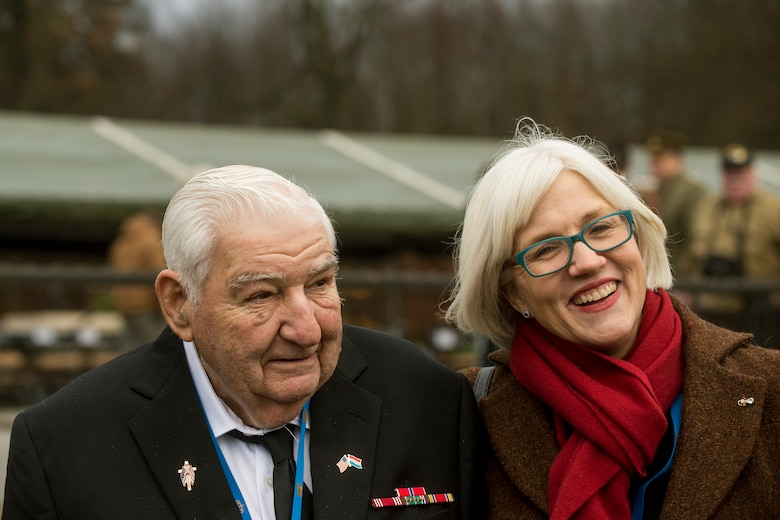 George Merz, a World War II veteran, and Helen Patton, granddaughter of U.S. Army Gen. George Patton, pose for a picture after a ceremony at Luxembourg American Cemetery  and Memorial Dec. 16, 2014, in Luxembourg. Merz and other World War II veterans and their families attended the ceremony as well as Battle of the Bulge-related sites throughout Belgium and Luxembourg. (U.S. Air Force photo by Senior Airman Rusty Frank/Released)