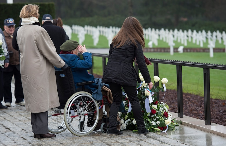 A World War II veteran salutes a memorial wreath during the Battle of the Bulge 70th Anniversary ceremony at the Luxembourg American Cemetery and Memorial in Luxembourg, Dec. 16, 2014. The U.S. Embassy and government of Luxembourg hosted the ceremony to commemorate those who gave their lives during the battle, as well as the surviving veterans of World War II. (U.S. Air Force photo by Staff Sgt. Chad Warren/Released)