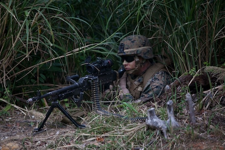 U.S. Marine with Company E, Battalion Landing Team, 2nd Battalion 4th Marines, 31st Marine Expeditionary Unit (MEU), provides security during a vertical assault as part of the MEU Exercise (MEUEX), in Combat Town, Okinawa, Japan, Dec 10, 2014. BLT 2/4 is conducting training in preparation of their upcoming spring patrol.