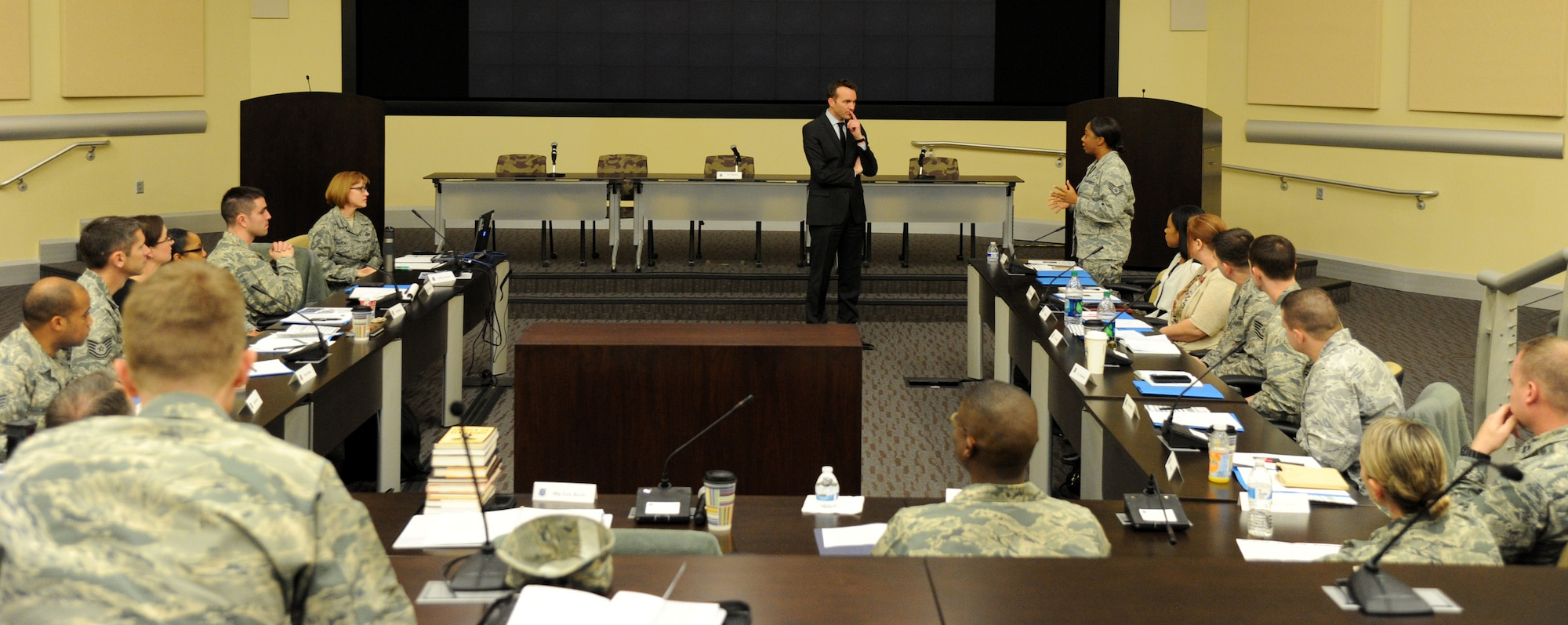 Eric Fanning, the under secretary of the Air Force, listens as Staff Sgt. Karin Nelson asks a questions about reserve duty during the annual Air Force District of Washington Capital Airman Seminar Dec. 16, 2014, on Joint Base Andrews, Md.,. Fifty-one enlisted, officer, and civilian Airmen were selected from across the National Capital Region to attend the four-day professional development seminar. Nelson, a reservist aerospace medical technical assigned to the 459th Air Refueling Wing, is on active-duty orders at the AFDW. (U.S. Air Force photo/Master Sgt. Tammie Moore)