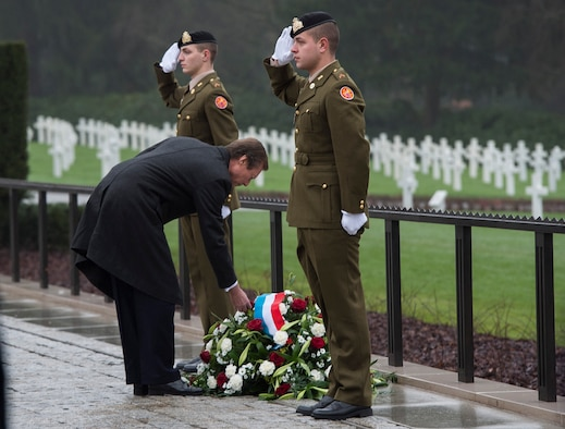 Grand Duke Henri of Luxembourg places a flower on a memorial wreath during the Battle of the Bulge 70th anniversary ceremony at the Luxembourg American Cemetery and Memorial Dec. 16, 2014, in Luxembourg. The cemetery holds 5,076 fallen American service members, many of whom lost their lives during the Battle of the Bulge. (U.S. Air Force photo/Staff Sgt. Chad Warren)