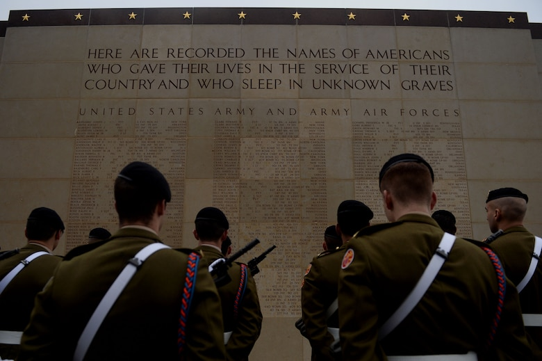 Luxembourg Army soldiers stand in formation in front of a wall commemorating fallen American service members before the Battle of the Bulge 70th anniversary ceremony Dec. 16, 2014, at the Luxembourg American Military Cemetery in Luxembourg. The cemetery holds the bodies of 5,076 U.S. service members, 101 of whom are unknown. (U.S. Air Force photo/Airman 1st Class Timothy Kim)