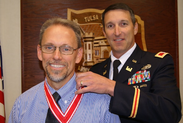 Col. Richard A. Pratt, commander, Tulsa District, U.S. Army Corps of Engineers presents Andrew Commer, Tulsa District's Chief of Regulatory Division, with the de Fleury medal for distinguished service to the Engineer Regiment.