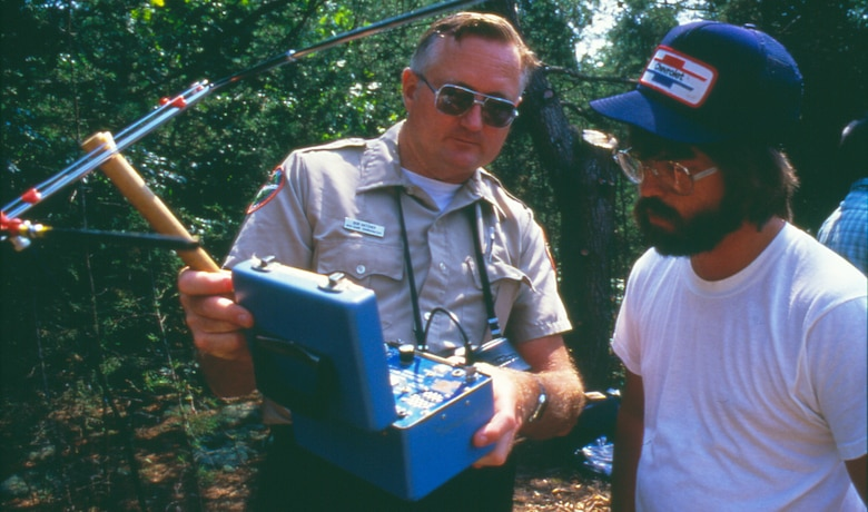 Bob Hatcher, Tennessee Wildlife Resources Agency, explains how to track the American Bald Eagle to Jimmy Carter, biology student at Tennessee Technological University, at Dale Hollow Lake Sept. 12, 1988. The U.S. Army Corps of Engineers released 44 eagles during the Eagle Restoration Program between 1987 and 1991.