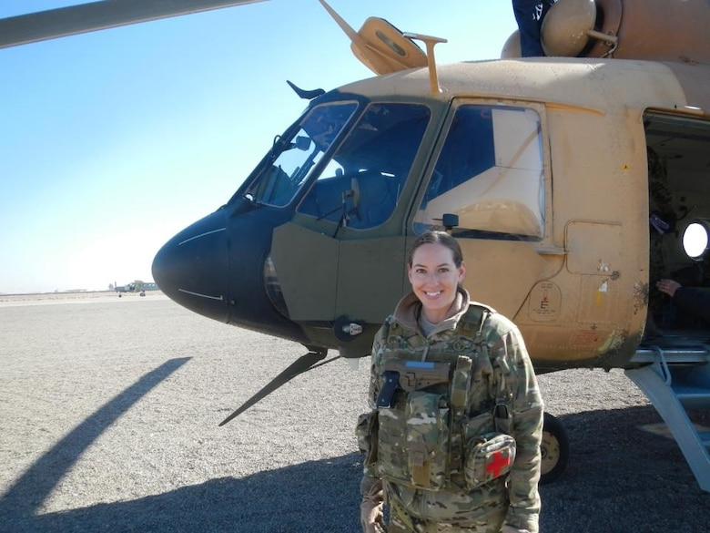 Maj. Mary Clark, a UH-1N Huey instructor pilot and the 58th Operations Support Squadron's assistant director of operations, recently made an impact by training pilots, male and female, for the Afghan Air Force at Shindand Air Base, Afghanistan. (Courtesy photo)