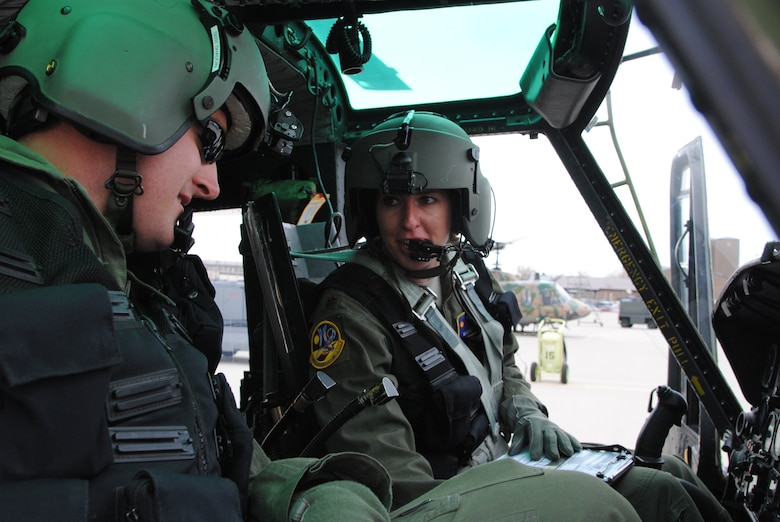 Maj. Mary Clark, a UH-1N Huey instructor pilot and 58th Operations Support Squadron assistant director of operations, instructs 1st Lt. David Shadoin, a student pilot in the 512th Special Operations Squadron, during pre-flight procedures Dec. 16. (US Air Force photo by Jim Fisher)