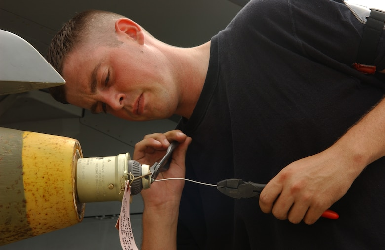 Montana Air National Guard Armament Systems Specialist Staff Sgt. Carl Valvoda prepares a fuse on a Mk-82 general purpose bomb while deployed to Kunsan Air Base, Republic of Korea July 5, 2006. (U.S. Air Force photo/Staff Sgt. Becky Nelson)