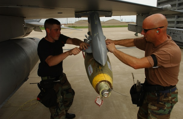 Montana Air National Guard Armament Systems Specialists Staff Sgt. Carl Valvoda and Tech. Sgt. Mike Geske secure a Mk-82 general purpose bomb during a deployment to Kunsan Air Base, Republic of Korea July 5, 2006. (U.S. Air Force photo/Staff Sgt. Becky Nelson)