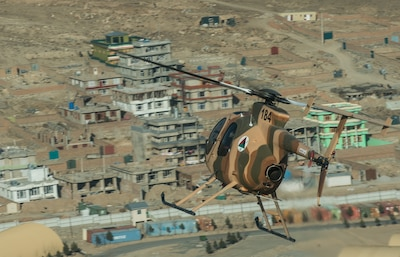 An MD 530 flies over Kabul, Afghanistan.  The MD 530 is a new aerial support aircraft the Afghan Air Force can use during Fighting Season '15.