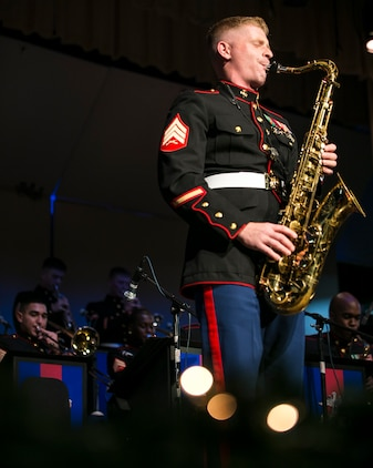 """Sgt. Michael A. Parker performs a saxophone solo for the song """"Have Yourself a Merry Little Christmas""""  Dec. 9 during a III Marine Expeditionary Force band Christmas concert at the Kubasaki High School auditorium on Camp Foster. The concert was filled with a variety of Christmas songs performed by the jazz ensemble of the III MEF band, known as the """"Big Band."""" The concert was open to the Okinawa public for an opportunity to share in the traditions of the Christmas season. Parker, a native of Syracuse, New York, is a saxophone musician with the III MEF band."""
