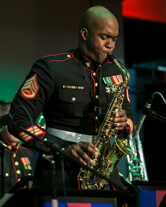 """Staff Sgt. D. DeMarius Jackson performs a saxophone solo for the song """"Deck the Halls""""  Dec. 9 during a III Marine Expeditionary Force band Christmas concert at the Kubasaki High School auditorium on Camp Foster. The concert was filled with a variety of Christmas songs performed by the jazz ensemble of the III MEF band, known as the """"Big Band."""" The concert was open to Okinawa community members for an opportunity to share in the traditions of the Christmas season. Jackson, a native of Aiken, South Carolina, is a saxophone musician with the III MEF band."""