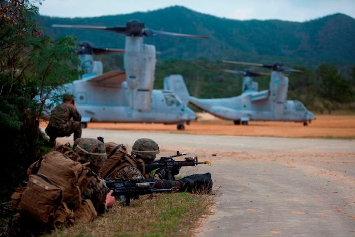 U.S. Marines with Company E, Battalion Landing Team, 2nd Battalion 4th Marines, 31st Marine Expeditionary Unit (MEU), provide security as Marines offload from a MV-22 Osprey as they conduct a vertical assault during MEU Exercise (MEUEX), in Combat Town, Okinawa, Japan, Dec 10, 2014. BLT 2/4 is conducting training in preparation of their upcoming spring patrol. (U.S. Marine Corps photo by GySgt Ismael Pena/Released)