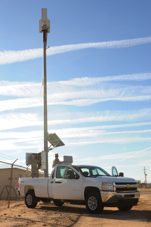 U.S. Air Force Senior Airmen Kevin Davis and Garrett Leeper, 355th Communications Squadron radio frequency transmissions systems technicians, perform a preventive maintenance inspection on a giant voice pole at Davis-Monthan Air Force Base, Ariz., Dec. 22, 2014. The 355th CS mission is to maintain and operate voice and data telecommunications along with computer network, radar and navigational aids. (U.S. Air Force photo by Airman 1st Class Cheyenne Morigeau/Released)