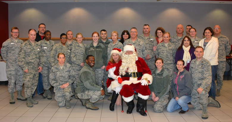 A group of Reserve and Guard Airmen pose for a photo before the Annual Normans Veterans Center Christmas Party Dec. 22.  (Courtesy Photo)