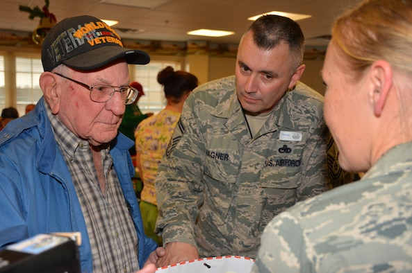 A World War II vet thanks Senior Master Sgt. Gary Wagner, 507th Maintenance Squadron for the Christmas gifts during the Annual Norman Veterans Center Christmas Party Dec. 22.  Wagner and more than 25 other Reserve and Guard Airman spent the day with the vets to listing to stories, making jokes and celebrating the holiday. (U.S. Air Force Photo/Maj. Jon Quinlan)