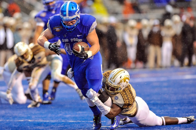 Air Force running back Shayne Davern powers his way to the Western Michigan 3-yard line in the first half of the Famous Idaho Potato Bowl in Boise, Idaho, Dec. 20, 2014, on a drive that gave Air Force a 20-10 lead. The Falcons defeated the Broncos, 38-24, with Davern running for 101 yards and two touchdowns. (U.S. Air Force photo/Liz Copan)