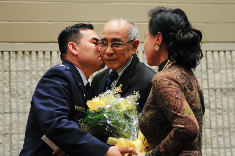 Air Force Lt. Col. Don Nguyen, assistant director of operations for the 273rd Information Operations Squadron (IOS), Texas Air National Guard, with his parents, Phuoc and Mai Nguyen, during his retirement ceremony in San Antonio, Nov. 23, 2014. Nguyen retired after 27 years of military service, including time with the Texas Army and Air National Guards. (U.S. Air National Guard photo by Tech. Sgt. Eric L. Wilson / Released) 141123-Z-IT549-003