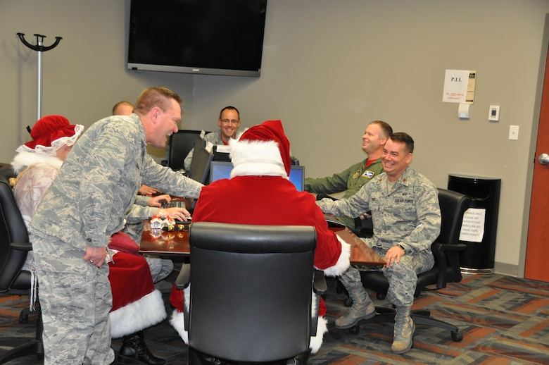 Santa and Mrs. Claus visits the Air Reserve Personnel Center Dec. 19, 2014, on Buckley Air Force Base, Colo. (U.S. Air Force photo/Tech. Sgt. Rob Hazelett)