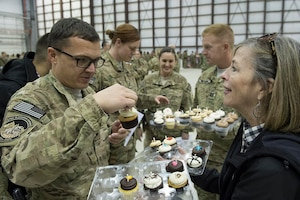 Deanie Dempsey hands out donated cupcakes after a USO show in Bagram Airfield, Afghanistan, Dec. 9, 2014. DoD photo by D. Myles Cullen