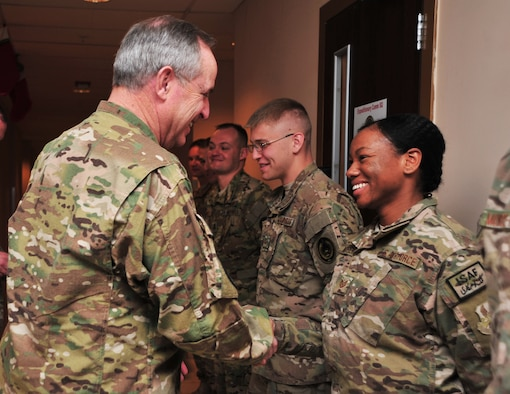 U.S. Air Force Chief of Staff Gen. Mark A. Welsh III shakes hands with U.S. Air Force Tech. Sgt. Delora Moorer, 455th Air Expeditionary Wing command chief executive assistant, after he recognized the Airman Dec. 15, 2014 at Bagram Airfield, Afghanistan. Welsh spent a portion of his visit to the Air Forces Central Command area of responsibility engaging with airmen, NCOs and officers during an Airman's Call. (U.S. Air Force photo by Staff Sgt. Whitney Amstutz/released)