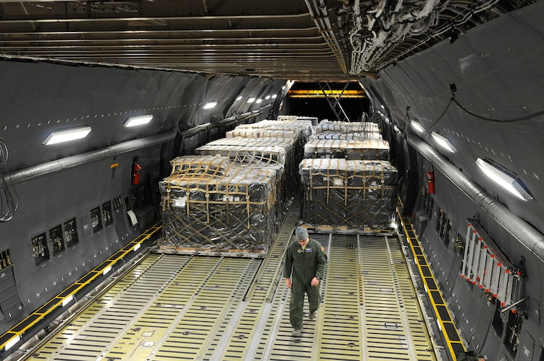 Reserve Airmen from the 512th Airlift Wing deliver humanitarian supplies to Nicaragua aboard a C-5M Super Galaxy Dec. 20, 2014, just in time for the holidays. The massive delivery was made possible through the Denton Program, a Defense Department humanitarian assistance transportation program that utilizes space available military air, surface and sea-lift assets. The supplies were provided to World Missions Outreach, which is an international nonprofit organization based in Nicaragua that provides food, education, medical and ministry services to the country's citizens. (U.S. Air Force photo/2nd Lt. Steve Lewis)