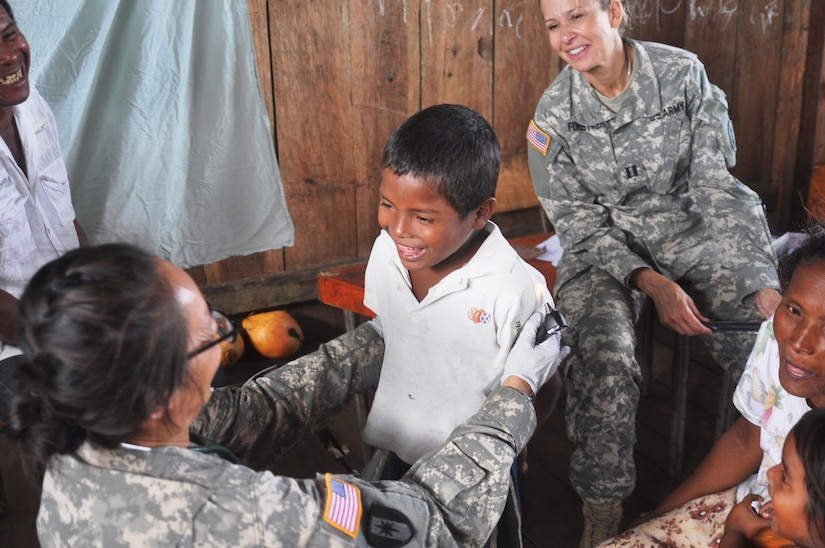 U.S. Army Maj. Juli Fung provides a medical screening for a Honduran child during a Medical Readiness Training Exercise in the Department of Gracias a Dios, Honduras. Dec. 17, 2014. Joint Task Force-Bravo's Medical Element provided medical care to more than 1,500 Honduran citizens during the two-day MEDRETE operation. (Photo by U.S. Army Staff Sgt. Jason Tedesco)