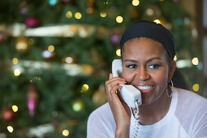 First Lady Michelle Obama discusses Santa's journey with children as part of the annual NORAD Tracks Santa program run by the North American Aerospace Defense Command. Mrs. Obama fielded calls from Hawaii, Dec. 24, 2014. Photo courtesy of The White House.