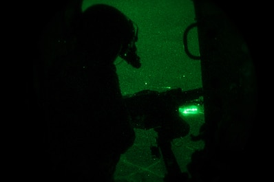 An Afghan air force Mi-17 gunner fires his M240B machine gun during the first night firing training mission, Nov 29, 2014 in Kabul, Afghanistan. This capability will allow the Afghan air force to take the fight to the enemy day and night. (U.S. Air Force photo by Staff Sgt. Perry Aston/Released)
