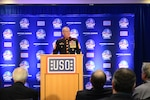 Marine Corps Sgt. Maj. Bryan B. Battaglia, senior enlisted advisor to the chairman of the Joint Chiefs of Staff, speaks during a USO reception at Navy-Marine Corps Stadium in Annapolis, Md., Dec. 27. Battaglia participated in pre-game festivities for the 2014 Military Bowl. DoD photo by Sgt. 1st Class Tyrone C. Marshall Jr.