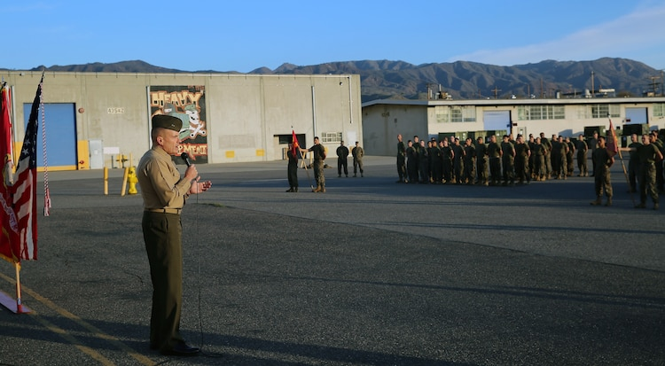Major Gen. Vincent Coglianese, commanding general 1st Marine Logistics Group, talks to Marines with 1st Maintenance Battalion, Combat Logistics Regiment 15, 1st MLG, during an award ceremony aboard Camp Pendleton, California, Dec. 19, 2014. (Marine Corps photo by Cpl. Cody Haas/ Released)