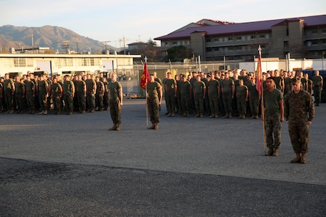 Marines with 1st Maintenance Battalion, Combat Logistics Regiment 15, 1st Marine Logistics Group, stand at the position of attention during an award ceremony aboard Camp Pendleton, California, Dec. 19, 2014. (Marine Corps photo by Cpl. Cody Haas/ Released)