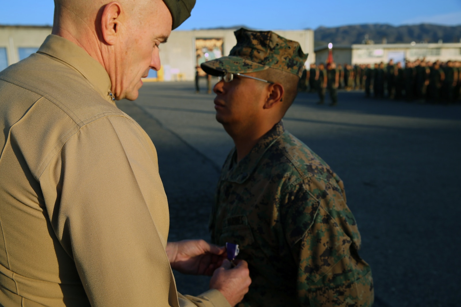 Corporal Ulises Zamoramartinez, an optics technician with 1st Maintenance Battalion, Combat Logistics Regiment 15, 1st Marine Logistics Group, recieves the Purple Heart Medal by Maj. Gen. Vincent Coglianese, commanding general 1st MLG, during an award ceremony aboard Camp Pendleton, California Dec. 19, 2014. Zamoramartinez, a 31-year-old native of Yakima, Washington, received the award for injuries received while deployed in Helmand province, Afghanistan during a six-month tour with Georgian Liaison Team 10, Regional Command (Southwest). (Marine Corps photo by Cpl. Cody Haas/ Released)