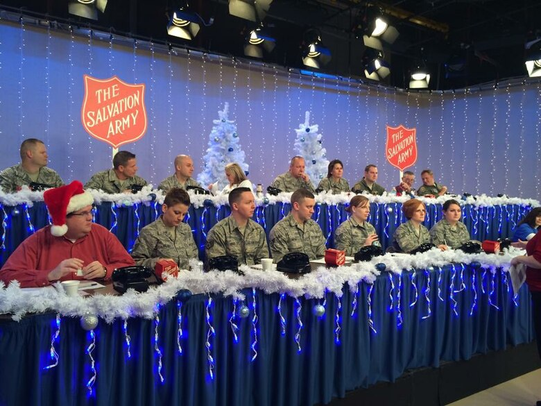 Members of the 171st Air Refueling Wing volunteered to take pledges from a phone bank for WTAE-TV's Project Bundle-Up Telethon Dec. 05, 2014. Project Bundle-Up is a joint partnership with The Salvation Army of Western Pennsylvania that raises money to provide winter outerwear to local children and senior citizens. (U.S. Air National Guard Photo/Released)