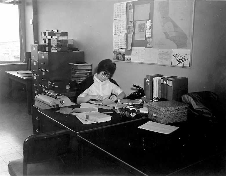 Sharon Caine, U.S. Army Corps of Engineers Sacramento District real estate division chief, is seen here in the mid 1960s while working in the district's engineering division, civil defense branch. At that time, the district surveyed buildings to determine suitability for fallout shelters. Caine will retire at the end of 2014 after having served the U.S. Army Corps of Engineers for 54 years. Most of that time was spent with the Corps' Sacramento District.