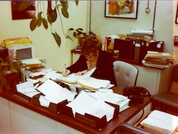 Sharon Caine, U.S. Army Corps of Engineers Sacramento District real estate division chief, is pictured working at her desk in the 1980s when she was a section chief in the real estate branch. Caine will retire at the end of 2014 after serving the U.S. Army Corps of Engineers for 54 years. Most of that time was spent with the Corps' Sacramento District.