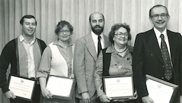 Sharon Caine (second from left), U.S. Army Corps of Engineers Sacramento District real estate division chief, stands with other district employees after receiving awards from the district commander in the 1970s. Caine will retire at the end of 2014 after serving the U.S. Army Corps of Engineers for 54 years. Most of that time was spent with the Corps' Sacramento District.
