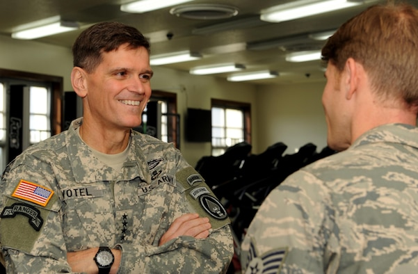 U.S. Army Gen. Joseph Votel, commander of U.S. Special Operations Command, speaks with Staff Sgt. Dustin Gorski, a pararescueman from the 320th Special Tactics Squadron, during a visit to the Human Performance Center at Kadena Air Base, Japan Dec. 15, 2014.  General and Mrs. Votel toured the facilities and met with staff members to see the program's efforts in support of the Preservation of the Force and Family initiative.  (U.S. Air Force photo by Airman 1st Class Zade Vadnais)