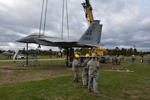 Airmen from the Crash, Damage, Disabled Aircraft Recovery training team work together to recover a jet during an exercise at Volk Field Air National Guard Base, Camp Douglas, Wis., Oct. 4, 2014. CDDAR teams from across the nation were tested with simulated aircraft crash exercises, and as their leadership stood back, were forced to make decisions on how to transport and/or recover the aircraft. (U.S. Air National Guard photo by Staff Sgt. Ryan Roth)