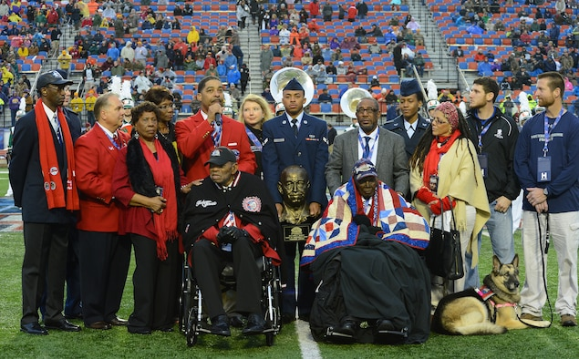 "Tuskegee Airmen Homer Hogues and Calvin Spann receive the Omar N. Bradley ""Spirit of Independence Award"" on behalf of all of the Tuskegee Airmen during the Duck Commander Independence Bowl at Shreveport, La., Dec. 27, 2014. The Omar N. Bradley ""Spirit of Independence Award"" is named after the last individual in the United States Armed Forces to hold the 5-star rank. It was named after him because he embodied the spirit of independence. (U.S. Air Force photo/Senior Airman Joseph A. Pagán Jr.)"