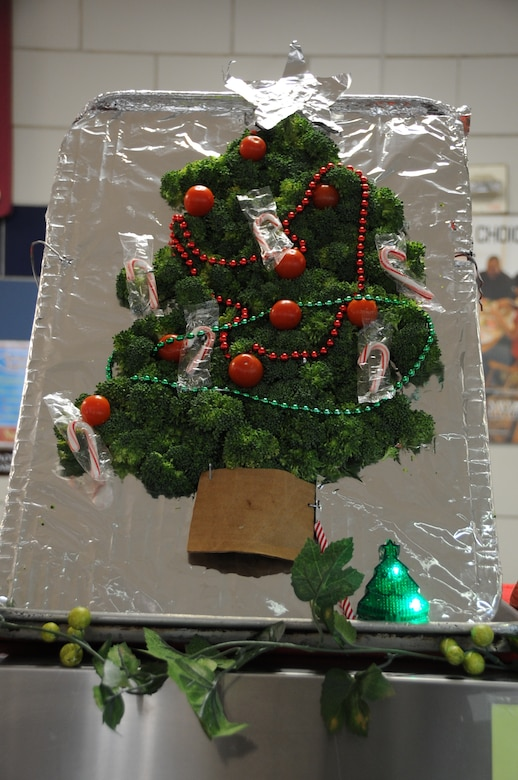 A broccoli and tomato Christmas tree stands on display at the Weapons Station Galley, Dec. 25, 2014, at Joint Base Charleston, S.C. Cheryl Cote and Elizabeth Bohr, Galley line supervisors, were asked to add ambiance for the Sailors by creating decorations from readily available kitchen items. The Galley staff and their Air Force counterparts at the Gaylor Dining Facility on the Air Base, prepared delicious meals for service members at Joint Base Charleston, many of whom are stationed away from friends and families. (U.S. Air Force photo/Capt. Christopher Love)
