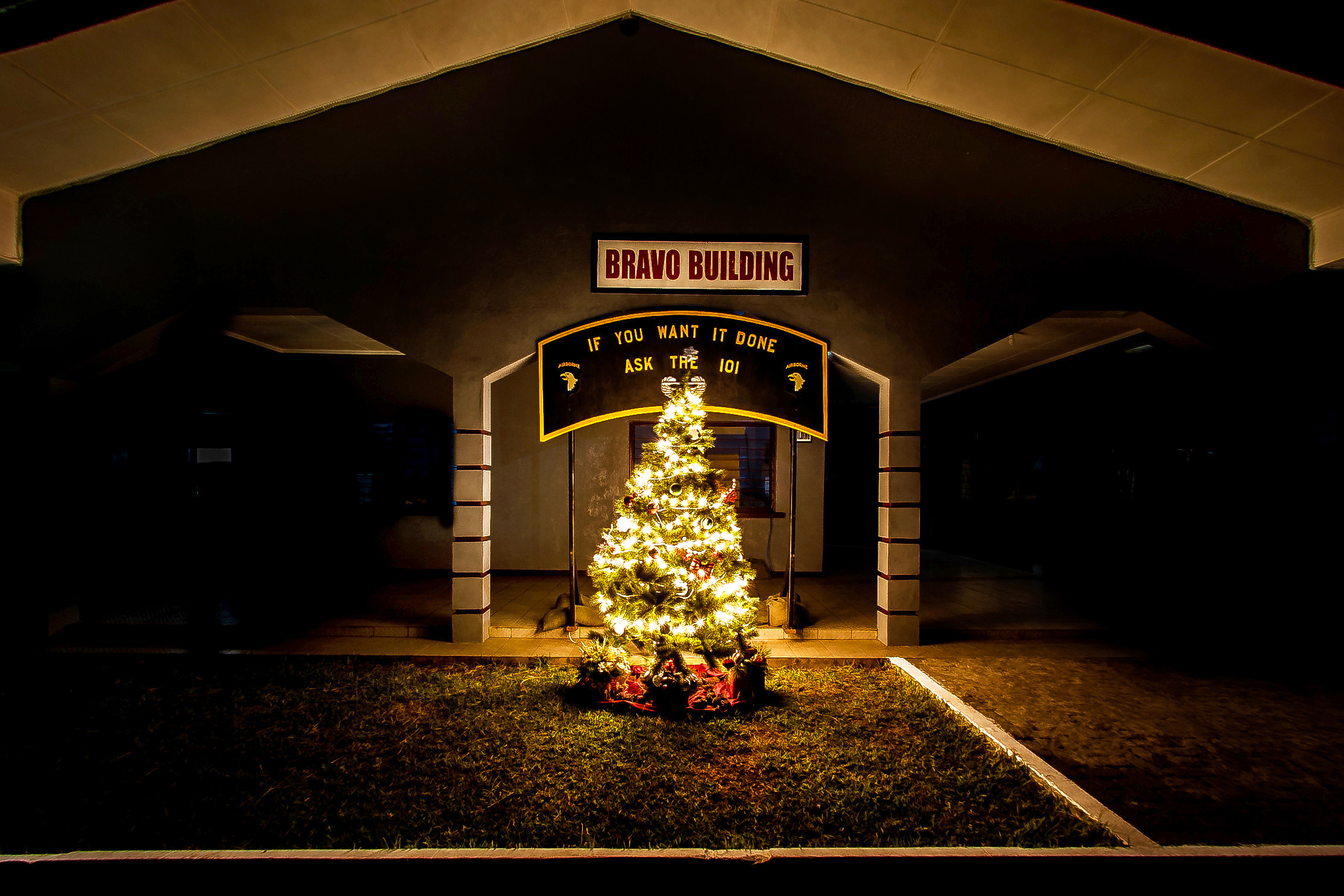 the joint forces united assistance christmas tree shines in front of the headquarters building at - Christmas Assistance 2014