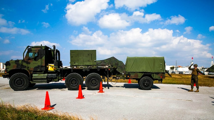 Marines navigate a Medium Tactical Vehicle Replacement, also known as the 7-Ton, through a set of zig-zag cones Dec. 9 as part of a Truck Rodeo on Camp Kinser. The rodeo had multiple events designed to test motor transport units, which came from different bases on Okinawa. It was also a good opportunity to build camaraderie among the motor transport community. The Marines are with Marine Air Control Group 18, 1st Marine Aircraft Wing, III Marine Expeditionary Force.