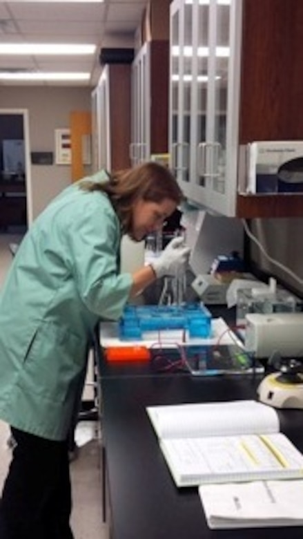 Denise Lindsay, CEGT, loading PCR product onto an agarose gel to verify whole mtDNA amplification of endangered gray bat samples.