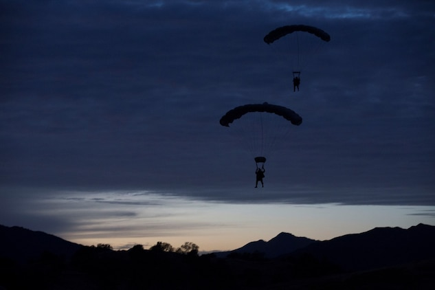 U.S. Marines with the Force Reconnaissance Detachment, 15th Marine Expeditionary Unit, conduct a static-line jump from an MV-22B Osprey during realistic urban training aboard Fort Hunter Liggett, Calif., Dec. 9, 2014. These Marines are part of the 15th MEU's Maritime Raid Force. The purpose of RUT is to provide the MEU an opportunity to conduct training in unfamiliar environments in preparation for their upcoming deployment. (U.S. Marine Corps photo by Cpl. Anna Albrecht/Released)